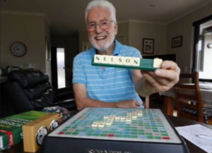 Image showing smiling man holding tile rack with letters spelling Nelson.